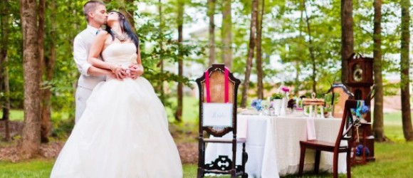 alice-in-wonderland-tea-party-wedding-inspiration-bride-and-groom-with-tablescape-550x366[1]